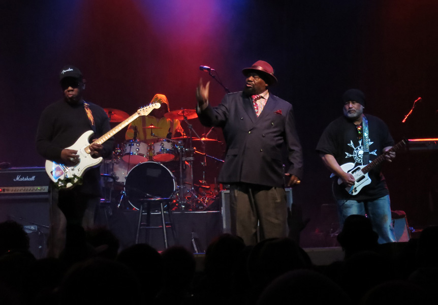 George Clinton leads the charge on stage.